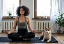 Photo-of-woman-and-dog-sitting-on-yoga-mat