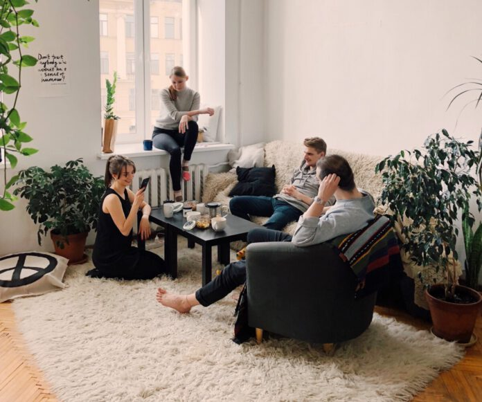 people-gathered-around-a-table -in-the-living-room-in-the-Netherlands