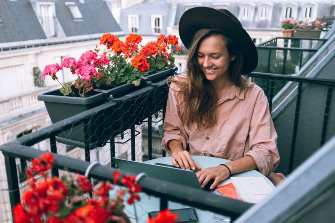 Dutch-woman-wearing-a-hat-working-from-home-outside