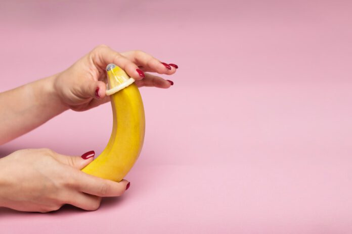 photo-of-hands-putting-condom-on-banana
