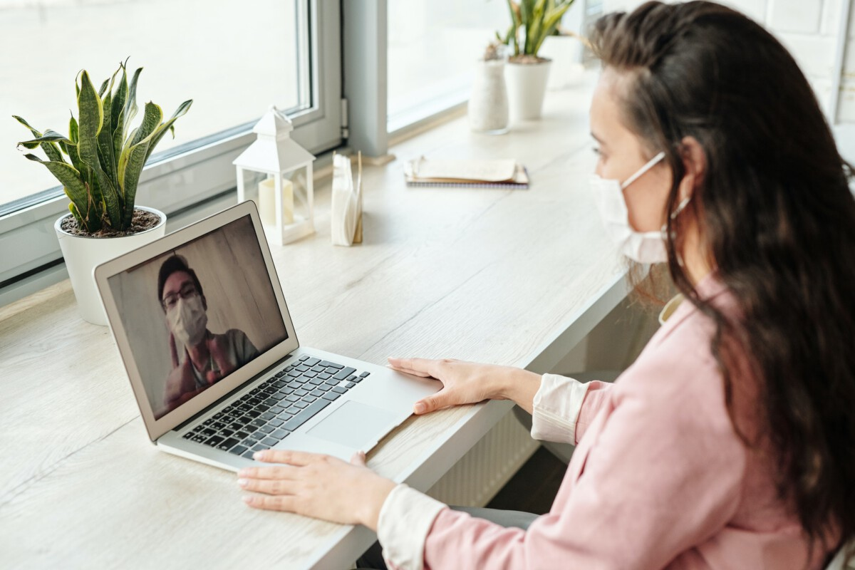 photo-of-a-couple-video-calling