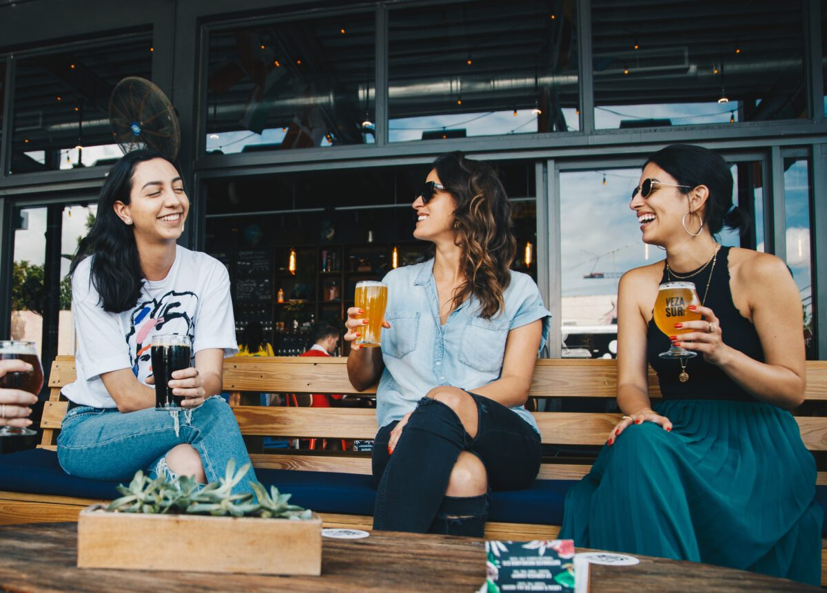 photo-of-three-female-friends-having-a-beer-on-a-terrace-in-the-netherlands