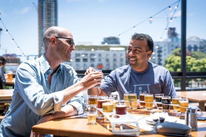 photo-of-two-men-beer-tasking