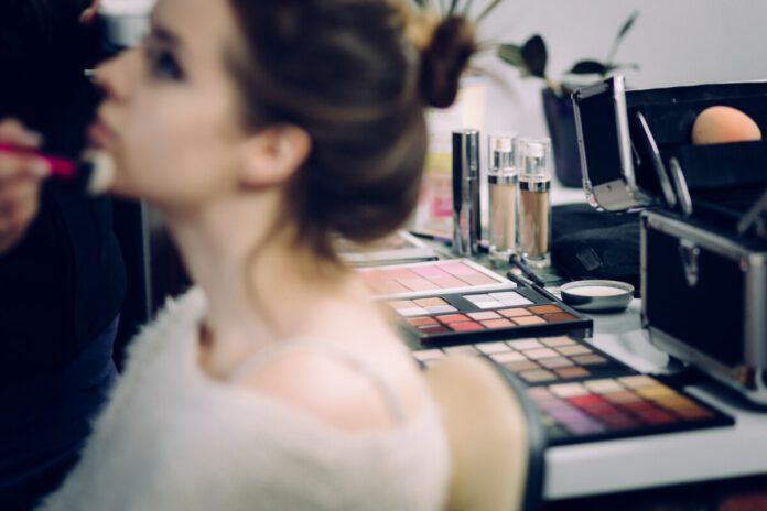 girl-having-makeup-applied