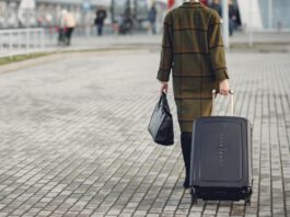 photo-of-girl-walking-with-suitcase