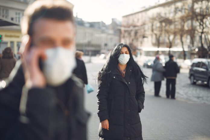 photo-of-two-people-outside-wearing-face-masks