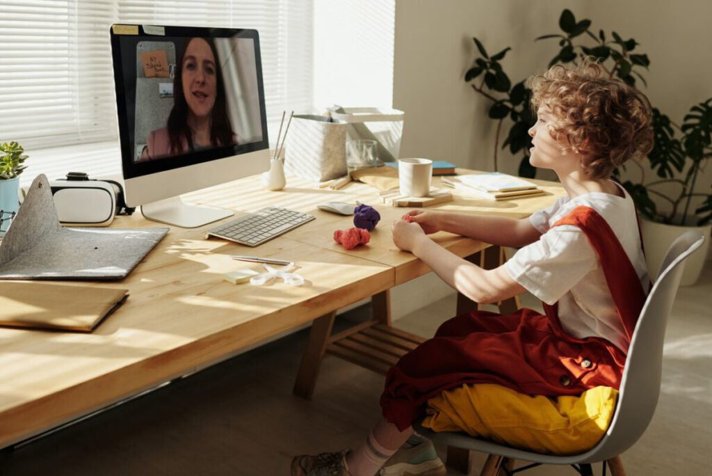 Photo-of-girl-sitting-at-desk-for-online-school