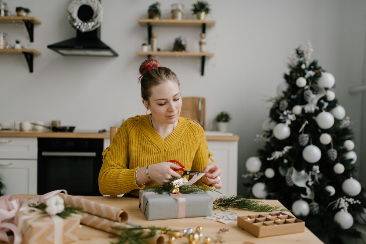 photo-of-a-woman-wrapping-christmas-presents