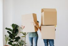 Photo-of-people-holding-boxes-getting-a-mortgage