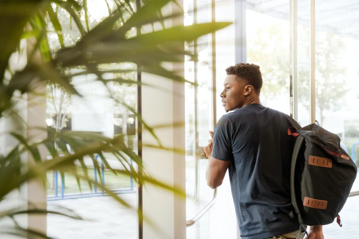 student-leaving-through-door
