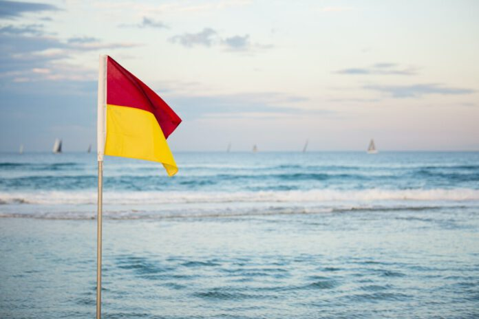 red-yellow-flag-showing-hazards-on-dutch-beach