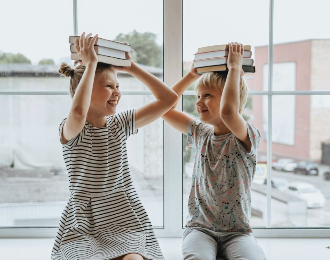 photo-of-a-brother-and-a-sister-with-books