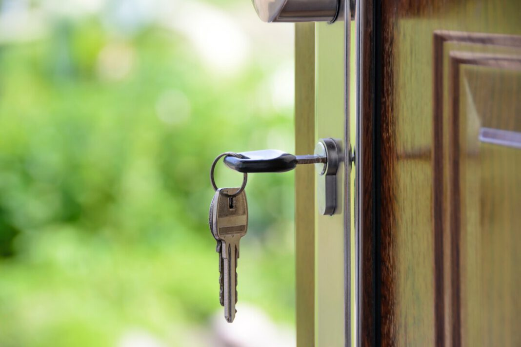 photo-of-key-in-door-after-buying-house-in-netherlands