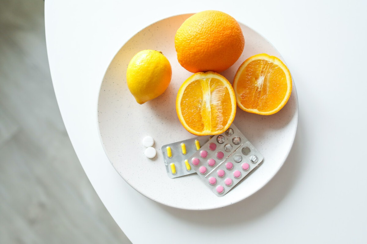 plate with medicine and oranges