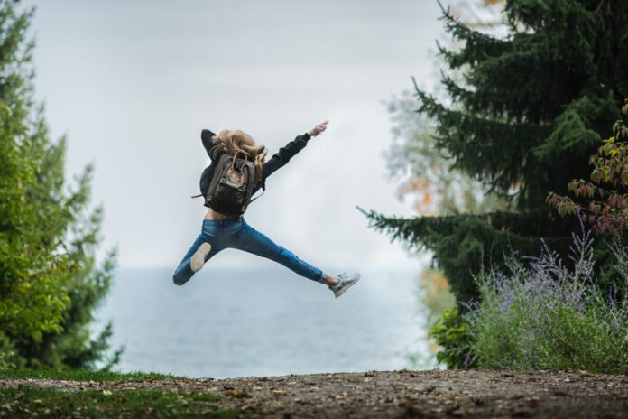 girl-jumping-in-air-in-forest