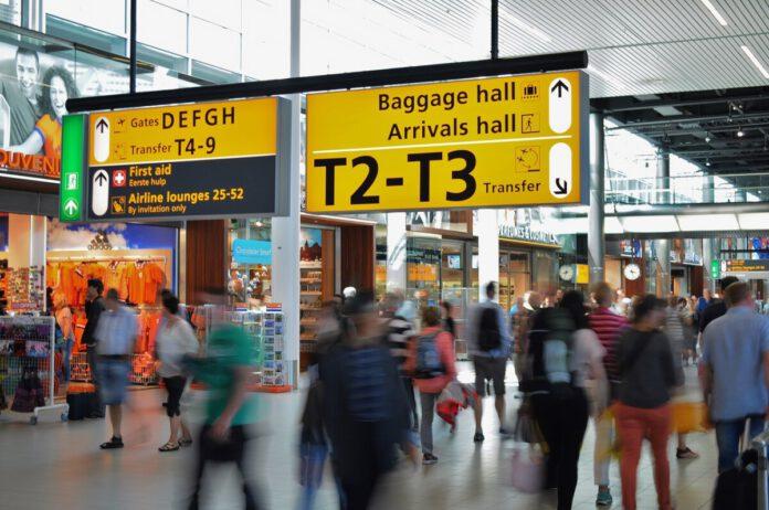 People - walking - through- airport