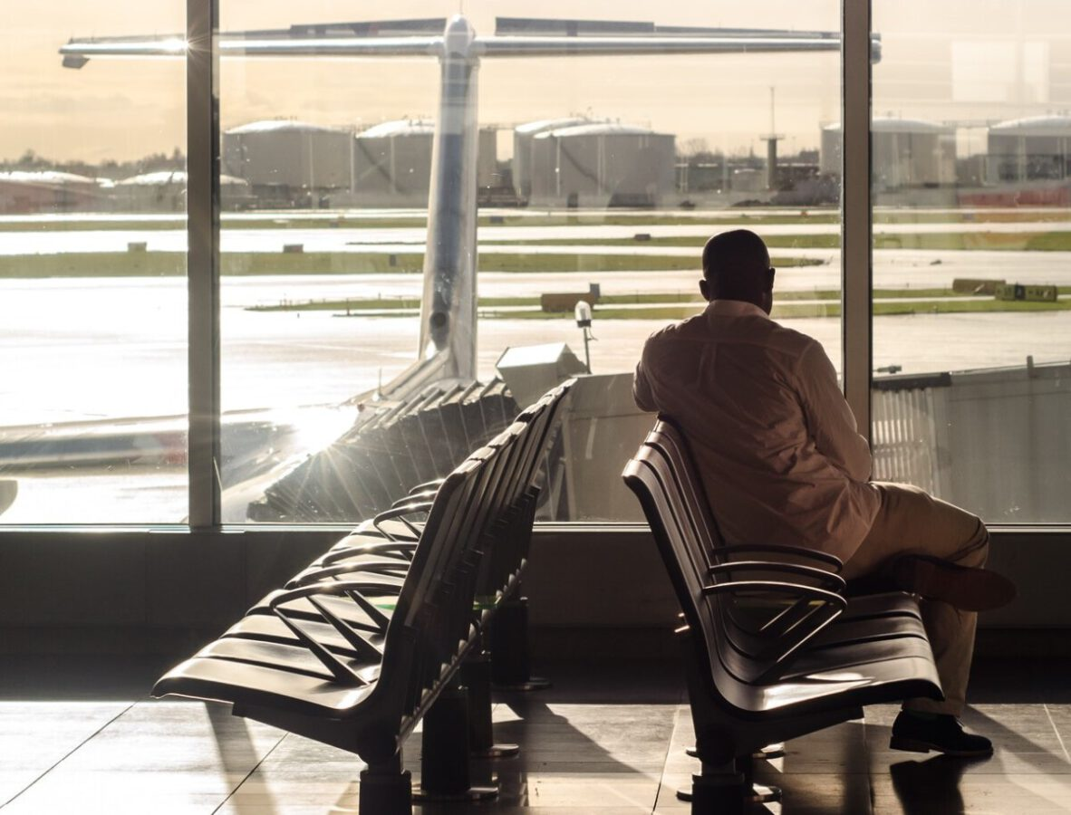 man-waiting-in-an-empty-airport