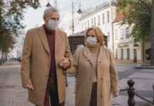 elderly couple wearing masks