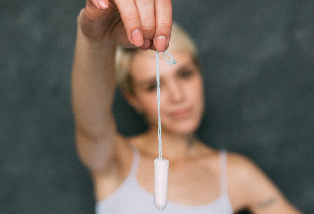 photo-of-Dutch-girl-dangling-tampon-by-string
