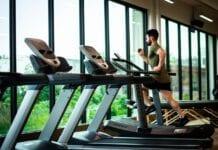 Photo-of-man-running-in-gym-on-treadmill
