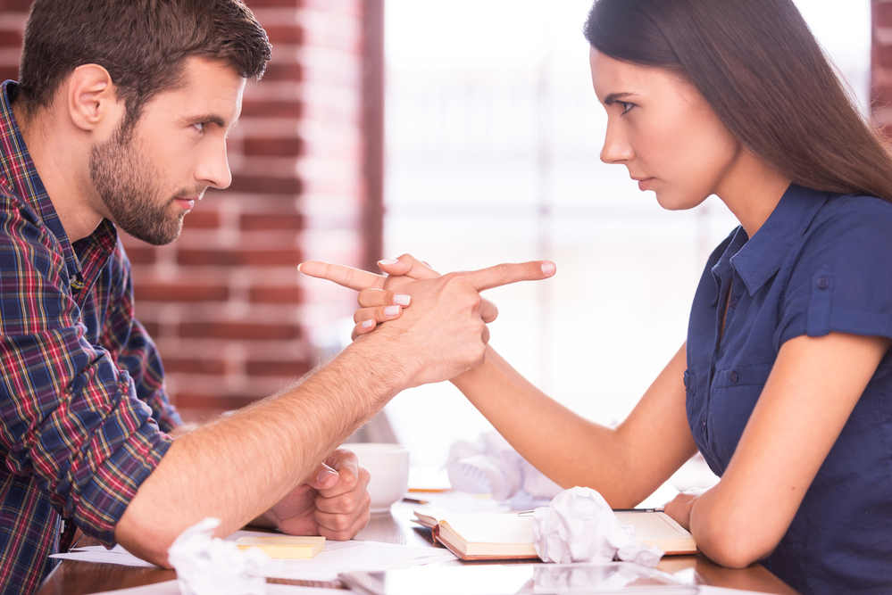 man-and-woman-pointing-fingers-at-each-other