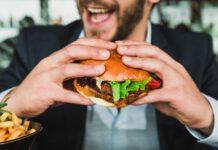 Photo-of-man-eating-veggie-burger
