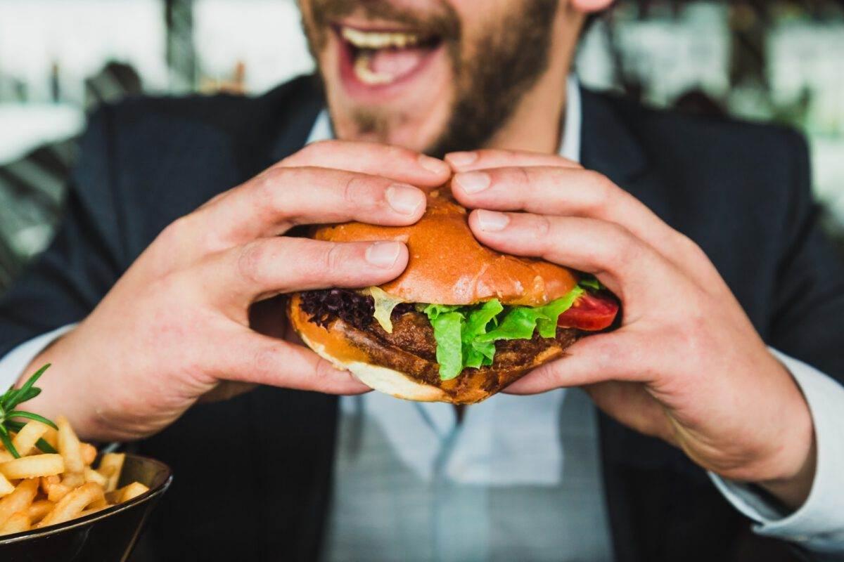 Dutch-woman-eating-a-meat-replacment-burger