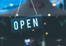 open-sign-hanging-on-store-restaurant-door