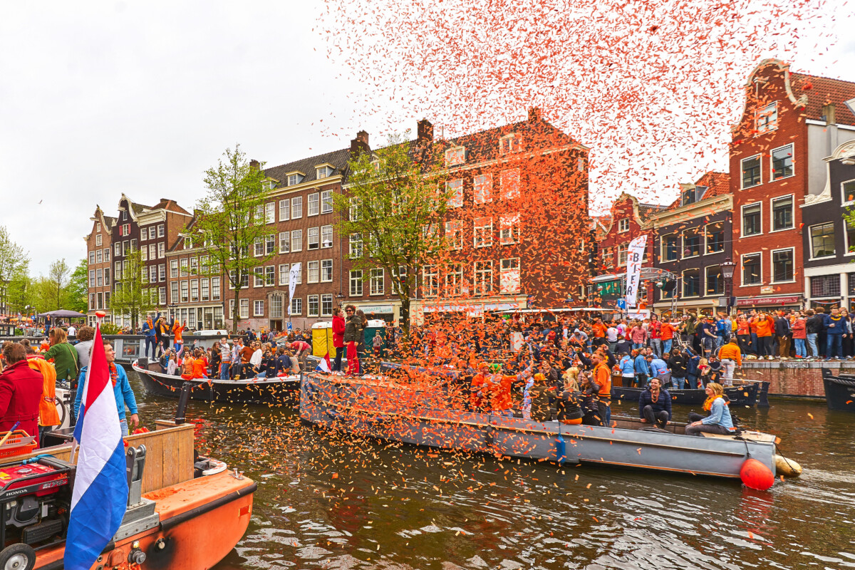 photo-of-confetti-falling-on-boat-in-dutch-canal-kings-day