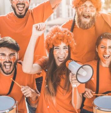 photo-of-dutch-fans-wearing-orange-cheering