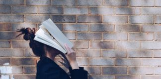 Photo-of-woman-holding-book-to-face