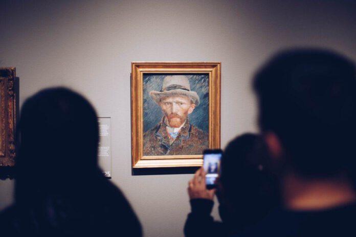 photo-of-people-looking-at-the-van-gogh-self-portrait