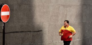 DHL delivery person running