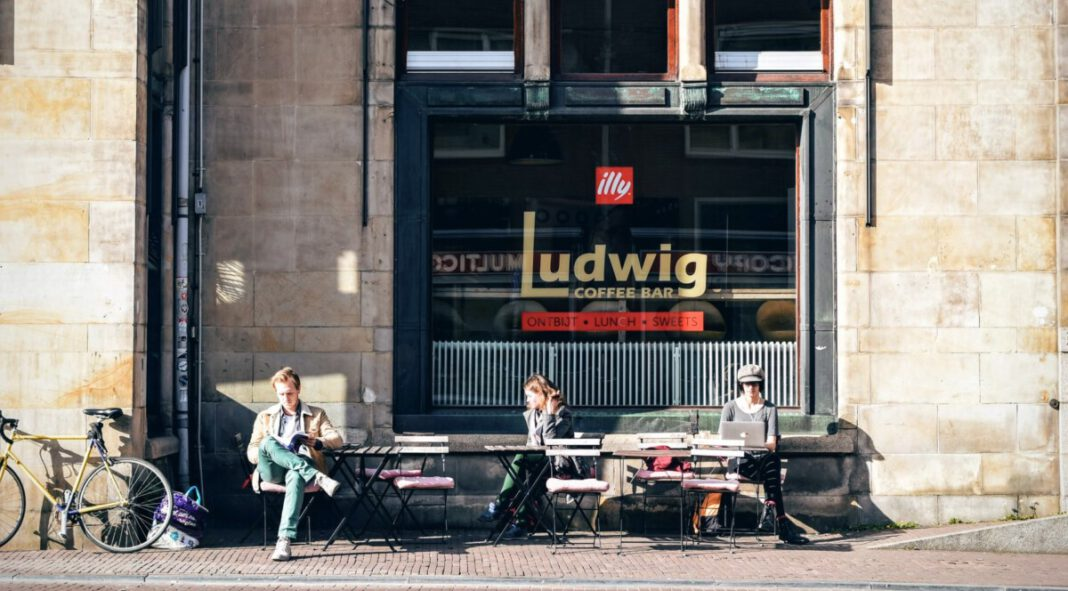 photo-of-three-people-sitting-outside-a-cafe-in-the-netherlands