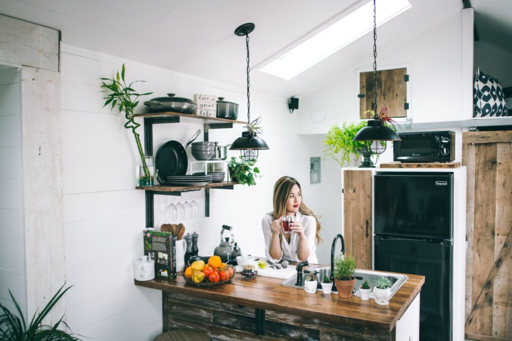 Photo-of-woman-sitting-in-kitchen-utilities-Netherlands