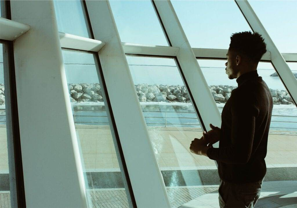 Photo-of-cross-border-worker-looking-out-window