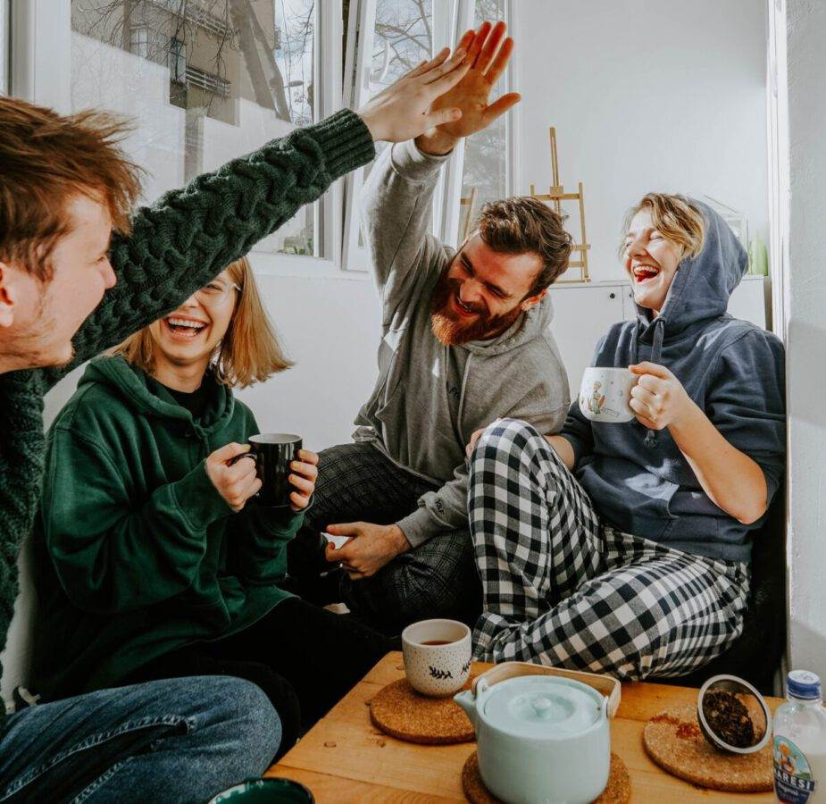 photo-of-a-happy-group-of-friends-having-a-coffee-indoors