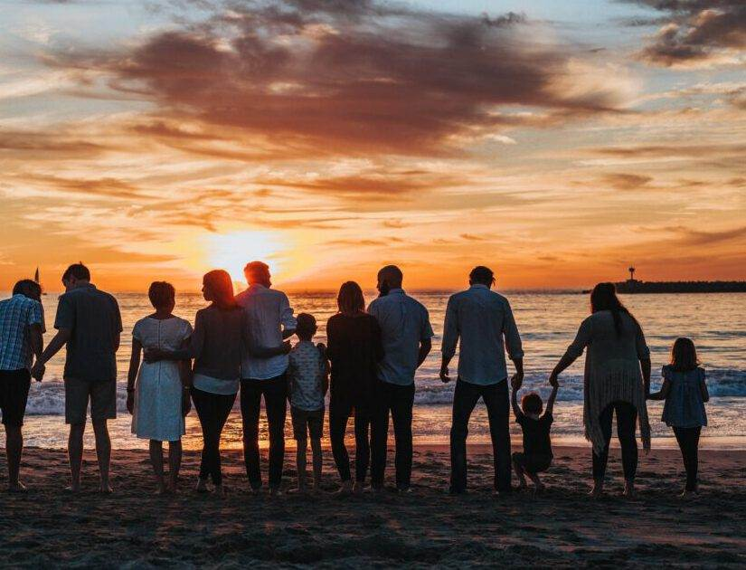 Photo-of-group-of-people-and-children-holding-hands-on-beach
