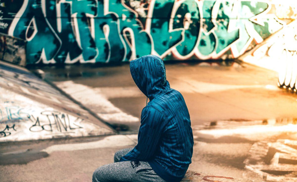 Photo-of-boy-wearing-hoodie-sitting-down