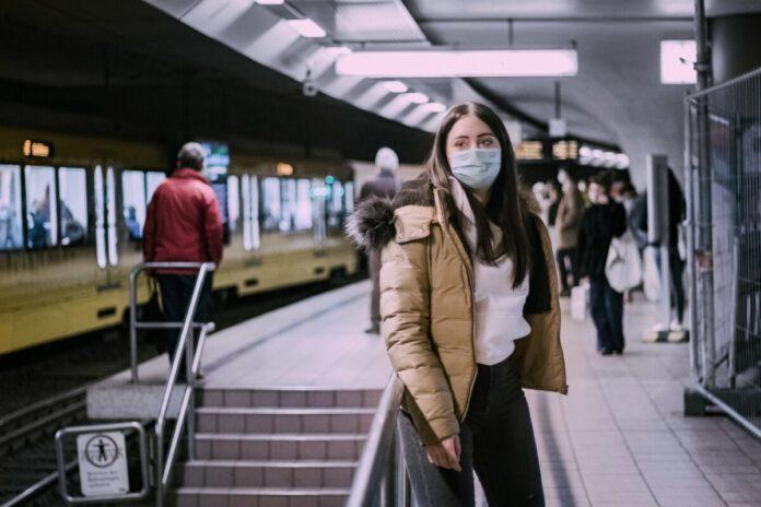 photo-of-a-woman-waiting-for-the-train-coronavirus