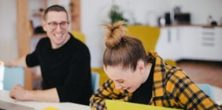 photo-of-woman-at-dutch-workplace-laughing-at-colleagues-joke