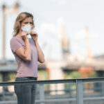 woman-wearing-coronavirus-mask-on-bridge