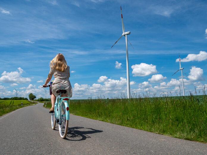 woman-on-bike-near-windmills-netherlands